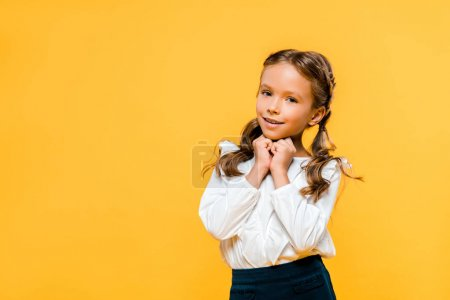 Photo for Happy and cute kid looking at camera isolated on orange - Royalty Free Image