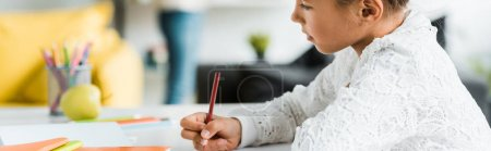 Photo for Panoramic shot of cute kid drawing with color pencil - Royalty Free Image