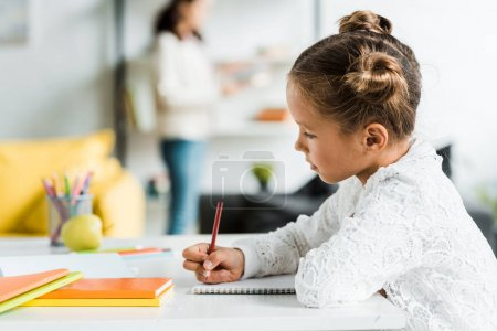 Photo for Selective focus of cute kid drawing with color pencil - Royalty Free Image