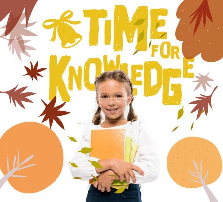 Photo for Happy schoolkid holding books near time for knowledge lettering on white - Royalty Free Image