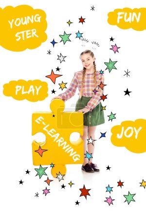 Photo for Smiling kid with e-learning lettering on jigsaw puzzle piece looking at camera on white - Royalty Free Image
