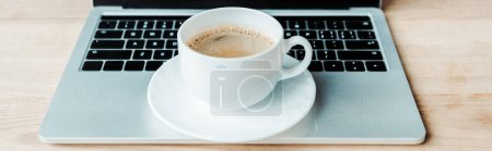 Photo for Panoramic shot of cup of coffee on laptop in office - Royalty Free Image