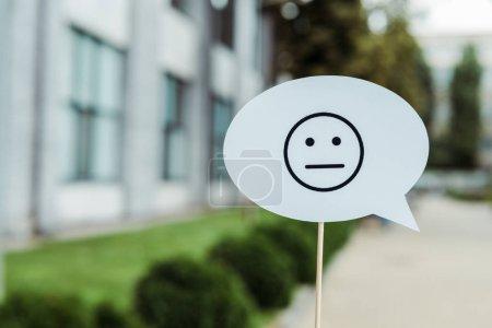KYIV, UKRAINE - AUGUST 5, 2019: sad face on speech bubble and stick