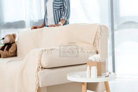 Photo for Cropped view of woman standing near sofa in living room - Royalty Free Image
