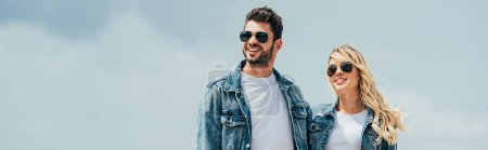 Photo for Panoramic shot of attractive woman and handsome man in denim jackets smiling outside - Royalty Free Image