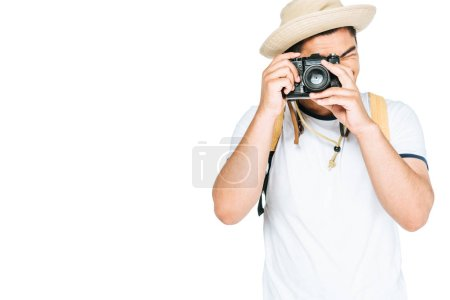 young asian man in hat taking photo on digital camera isolated on white