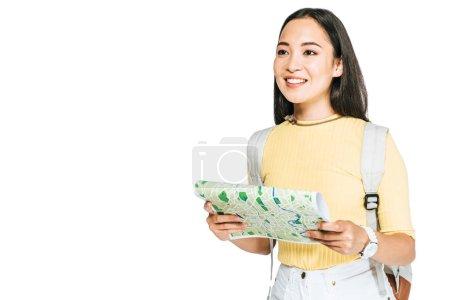 Photo pour Heureux asiatique fille holding carte et regarder loin isolé sur blanc - image libre de droit