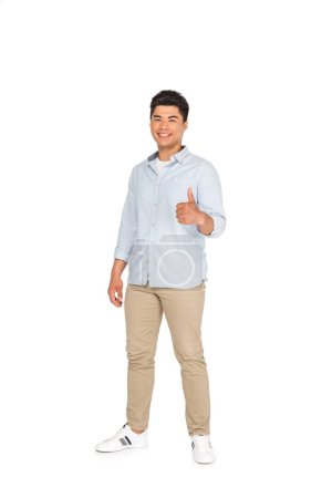 Photo for Handsome asian man showing thumb up while smiling at camera on white background - Royalty Free Image