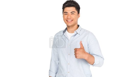Photo for Happy asian man showing thumb up while smiling at camera isolated on white - Royalty Free Image