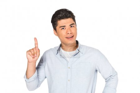 handsome asian man showing idea sign while looking at camera isolated on white