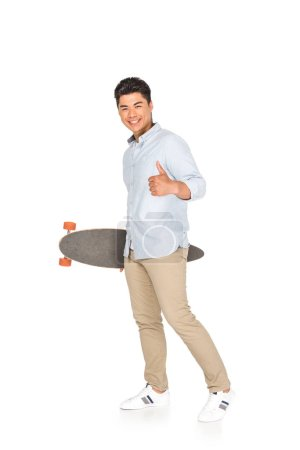 young asian man holding longboard while showing thumb up on white background