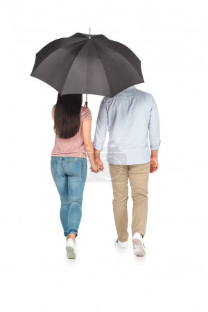back view of asian couple walking under umbrella and holding hands on white background