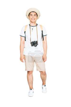 Photo for Handsome asian tourist in summer clothing looking at camera on white background - Royalty Free Image