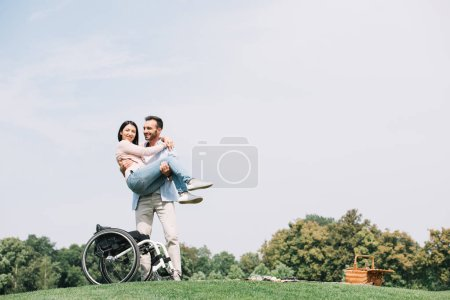 Photo for Cheerful young man holding on hands happy disabled girlfriend - Royalty Free Image