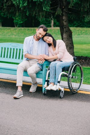 Photo for Pretty disabled woman with handsome boyfriend resting in park together - Royalty Free Image