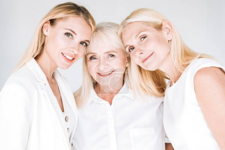 Photo for Three generation blonde beautiful women isolated on grey - Royalty Free Image