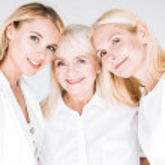 Three generation blonde beautiful women isolated o...