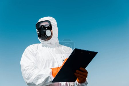 Photo for Man in protective mask and uniform holding clipboard - Royalty Free Image