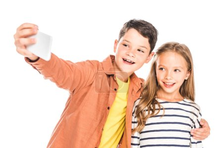 Photo for Two smiling kids taking selfie isolated on white - Royalty Free Image