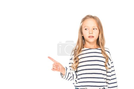 front view of child in casual outfit pointing with finger isolated on white