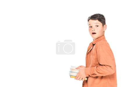 Photo for Shocked kid in shirt holding books isolated on white - Royalty Free Image