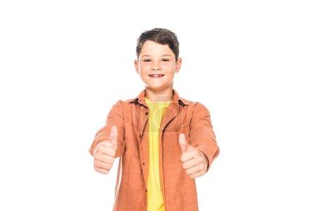 Foto de Vista frontal de niño sonriente mostrando pulgares hacia arriba aislados en blanco - Imagen libre de derechos