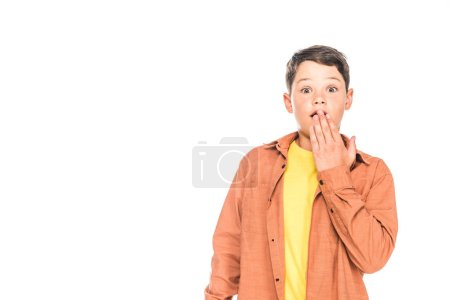 Photo for Front view of shocked kid in casual outfit covering mouth with hand isolated on white - Royalty Free Image