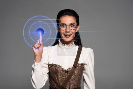 Photo for Front view of excited attractive steampunk woman showing idea sign isolated on grey - Royalty Free Image