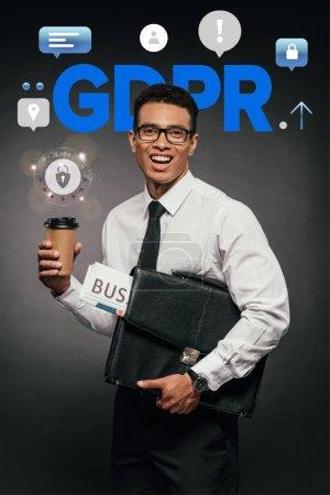 Photo pour Homme d'affaires américain et africain tenant un journal, un café pour aller et un porte-documents en cuir sur fond sombre avec illustration gdpr - image libre de droit