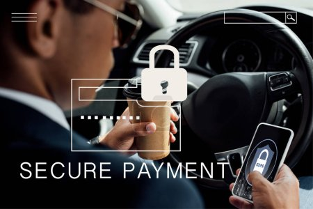 back view of african american businessman using smartphone and drinking coffee in car with secure payment illustration