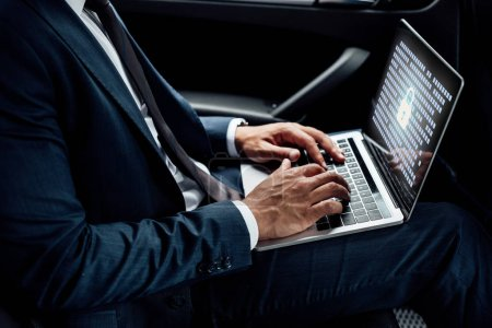 Photo for Partial view of african american businessman using laptop with gdpr illustration in car - Royalty Free Image