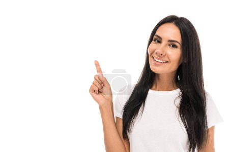 positive woman pointing with finger isolated on white