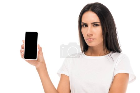 Photo for Displeased woman holding smartphone with blank screen isolated on white - Royalty Free Image