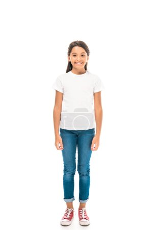 happy kid in blue jeans standing isolated on white