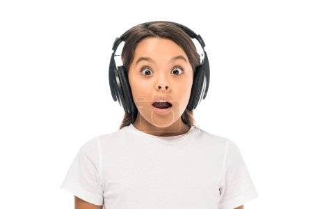 Photo for Shocked kid listening music in headphones isolated on white - Royalty Free Image