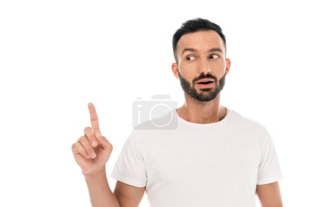 Photo for Surprised bearded man pointing with finger isolated on white - Royalty Free Image