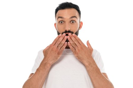 Photo for Shocked and bearded man covering mouth with hands isolated on white - Royalty Free Image