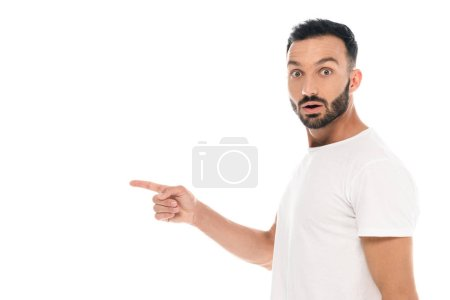 Photo for Surprised man pointing with finger and looking at camera isolated on white - Royalty Free Image