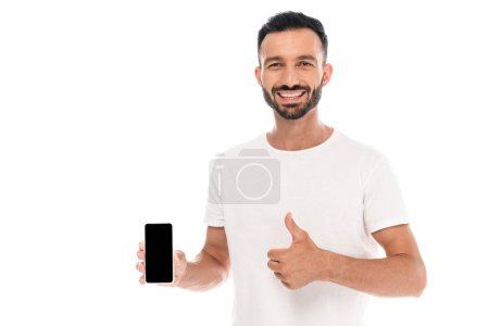 Photo for Cheerful man showing thumb up and holding smartphone with blank screen isolated on white - Royalty Free Image