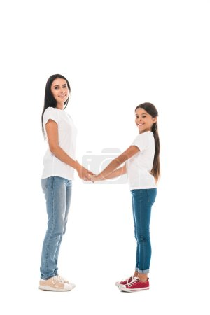 Photo for Cheerful mother and daughter holding hands isolated on white - Royalty Free Image