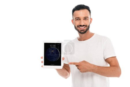 Photo for KYIV, UKRAINE - SEPTEMBER 3, 2019: Happy bearded man pointing with finger at ipad  isolated on white - Royalty Free Image
