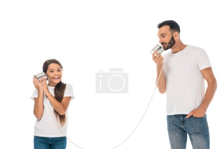 happy kid holding tin can and playing with bearded father isolated on while
