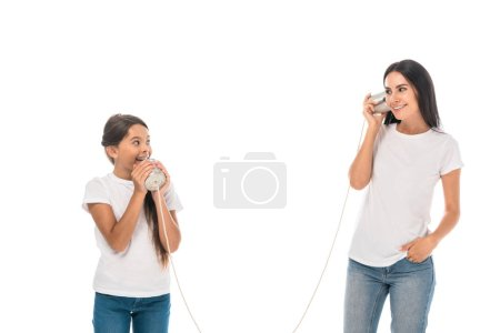 happy mother and daughter playing tin cans isolated on white