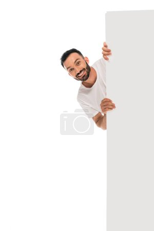 Photo for Cheerful man smiling while holding placard isolated on white - Royalty Free Image