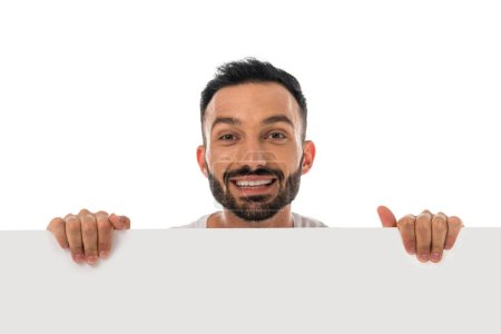 happy man smiling while holding placard isolated on white