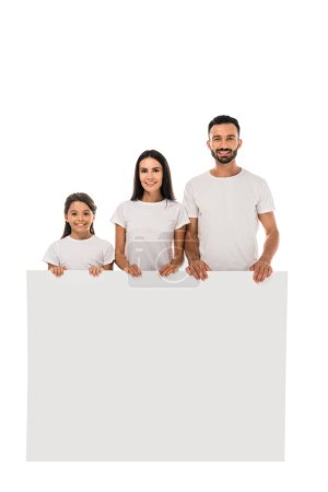 happy child standing with placard near mother and father isolated on white