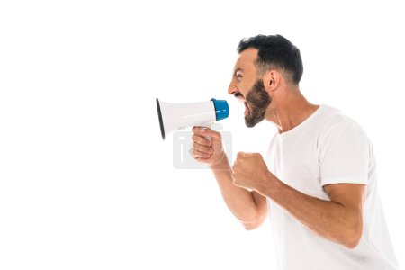 Photo for Side view of angry man with clenched fist screaming in megaphone isolated on white - Royalty Free Image