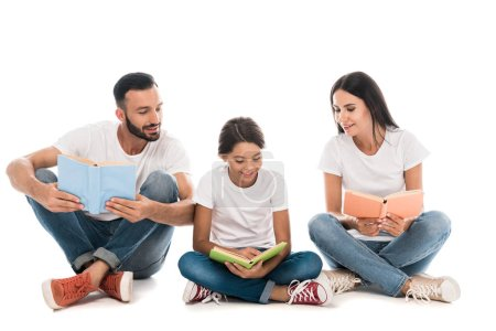 Photo for Happy family holding books while sitting isolated on white - Royalty Free Image