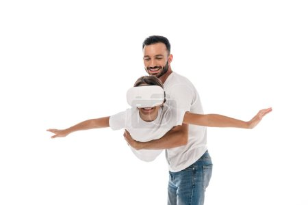 Photo for Happy father holding in arms cute kid in virtual reality headset isolated on white - Royalty Free Image