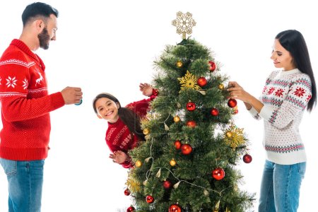 Photo pour Happy family decorating christmas tree isolated on white - image libre de droit